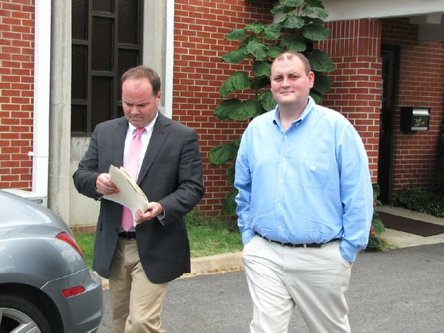 file-faulkner-county-administrator-jeff-johnston-right-walks-out-of-court-in-conway-with-his-attorney-joe-don-winningham-on-aug-30-2012