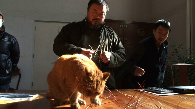 Chinese Conceptual Artist And Political Provocateur Ai Weiwei Is Shown With One Of His 40 Cats In Alison Klaymans Documentary Ai Weiwei Never Sorry