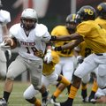 Scout Alexander, left, a Siloam Springs running back, is chased down by Watson Chapel's Devonte Batt...