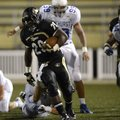 STAFF PHOTO MARC F. HENNING -- Bentonville running back Tearris Wallace breaks away for a big gain o...