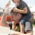 Chris Ravenscroft of Fayetteville holds an ice cream cone Thursday for his 3-yearold son, Ronan, whi...
