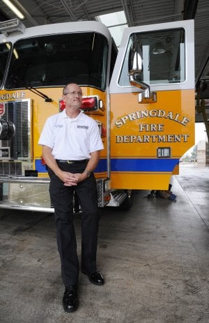 Springdale Fire Chief Mike Irwin sits Friday in the bay of Station No. 1 after his first week as the new fire chief.