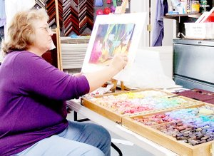 "Artist Susan Edgmon demonstrates the type of project students in her ""Exploring Pastels"" class will complete at NWACC's Bella Vista Center. Her class begins Sep- tember 24 and is open to anyone with an interest in art."
