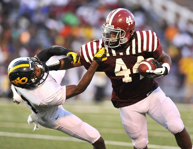 pine-bluff-fullback-kelvin-sergeant-right-stiff-arms-watson-chapel-cornerback-jordan-stargell-during-the-first-quarter-of-friday-nights-game-the-zebras-scored-48-first-half-points-en-route-to-a-48-12-victory