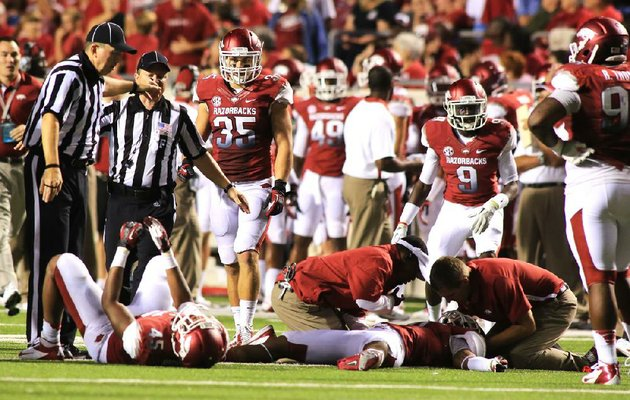 arkansas-cornerback-tevin-mitchel-is-attended-to-after-taking-a-hard-hit-during-the-fourth-quarter-of-a-game-against-louisana-monroe-on-saturday-sept-8-2012-at-war-memorial-stadium-in-little-rock-mitchel-suffered-a-concussion-when-he-and-linebacker-alonzo-highsmith-had-a-helmet-to-helmet-collision-while-making-a-tackle-mitchel-was-immobilized-and-carted-off-the-field