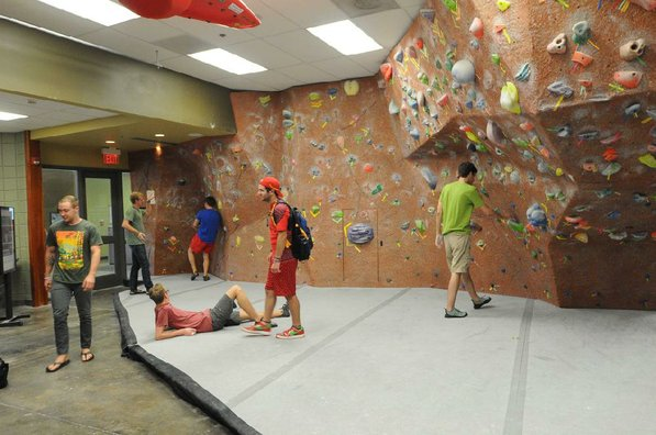 A bouldering wall with padded floor is popular with students.