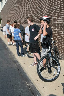 Lincoln Junior High students don helmets and select bicycles for Thursday's instruction.