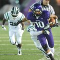 Jordan Dennis, Fayetteville junior receiver, heads to the end zone through the Muskogee, Okla., defe...