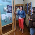 Kate Johnson, director of the Clinton House Museum, left, talks Friday to Nancy Walker of Franklinvi...