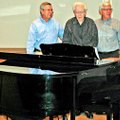 Willis Shaw, center, stands with sons Dennis Shaw, left, and Bob Shaw during a dedication of a piano...