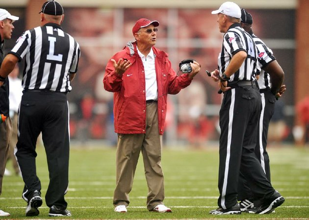 arkansas-coach-john-l-smith-speaks-with-referees-during-saturdays-game-at-reynolds-razorback-stadium-in-fayetteville-smith-said-he-took-responsibility-for-replacing-sophomore-deep-snapper-will-dappollonio-with-junior-will-coleman-early-in-the-game