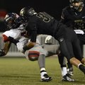 Jimmy Short, right, a Bentonville linebacker, lays a big hit on South Panola (Miss.) running back Da...