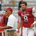 Arkansas Coach John L. Smith (left) and quarterback Tyler Wilson walk on the field before last Satur...
