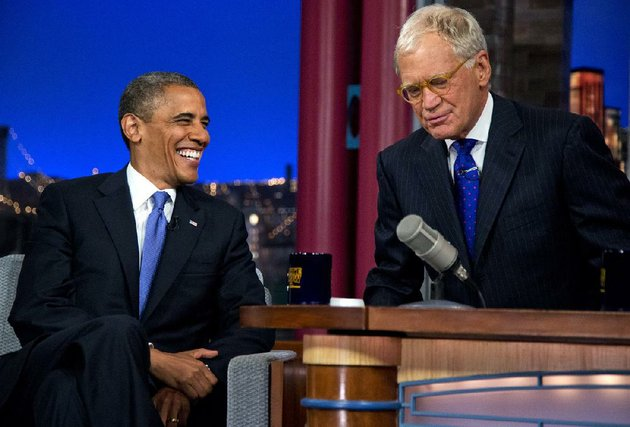 president-barack-obama-talks-with-david-letterman-on-the-set-of-the-late-show-with-david-letterman-at-the-ed-sullivan-theater-tuesday-sept-18-2012-in-new-york-ap-photocarolyn-kaster