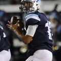 Kyle Pianalto, the Springdale Har-Ber quarterback, drops back to look for a open receiver Friday aga...