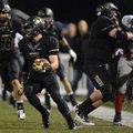 Chris Mizelle, a Bentonville cornerback, returns an interception 39 yards during the second quarter ...