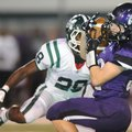 Cole Harris, right, a Fayetteville senior receiver, pulls down a 60-yard pass behind Muskogee (Okla....