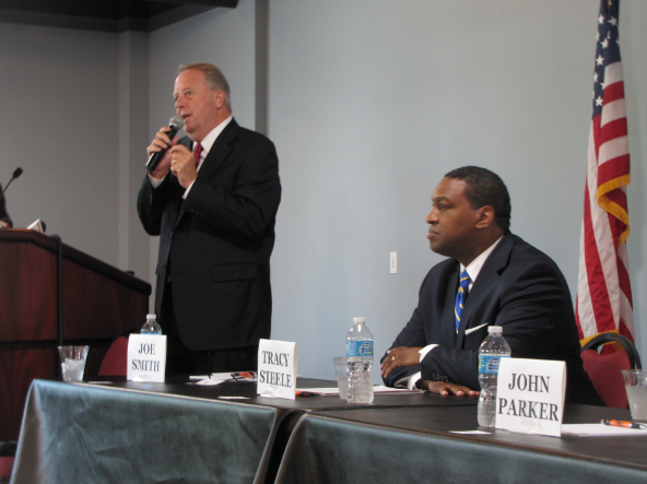 file-joe-smith-speaks-while-state-rep-tracy-steele-looks-on-during-a-forum-for-north-little-rock-mayoral-candidates-on-sept-20