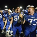 Dylan Bremer, left, Zachary Raphael, Zane Bush and Bryce Bray of Rogers High celebrate the Mounties'...