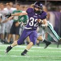 Cole Harris, Fayetteville, shakes Van Buren defender Wacey Connor as he runs Friday for a gain durin...