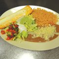 Traditional dishes such as chimichangas are served with home-made refried beans, rice and pica de ga...