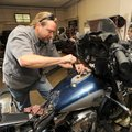 Bill Bryant, longtime motorcycle mechanic at Happy Trails Motorcycle Connection in Fayetteville, rep...