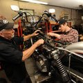 Joe Stevens, owner of Happy Trails Motorcycle Connection, left, works alongside his son, Walt, on Fr...