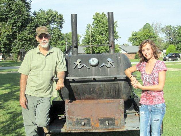 ricky-gilmore-is-shown-with-his-daughter-caitlin-ricky-is-a-multi-year-winner-of-jackson-countys-best-backyard-barbecue-contest-and-caitlin-is-a-winner-as-well-both-on-her-dads-team-and-alone