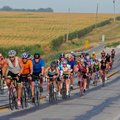 Riders steer their bikes — the kind with pedals — across Iowa during the annual RAGBRAI bicycle ride...
