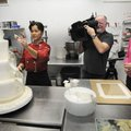 at Shelby Lynn Cake Shoppe, puts the finishing touches on a cake Thursday she'll be entering in the ...