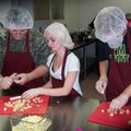 Justin Henderson, from left, Samantha Chinault and another student practice proper slicing and dicin...