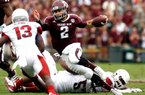 Johnny Manziel (2, shown playing the Arkansas Razorbacks) could help himself in the Heisman race during the Missouri at Texas A&M game.