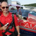 Patrick Carter, pilot and owner of Nflight Technologies, holds up a video camera Sept. 21 his compan...