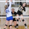 MacKenzie Muirhead, left, of Rogers High tries to block a kill by Bentonville's Anna LeDuc on Tuesda...