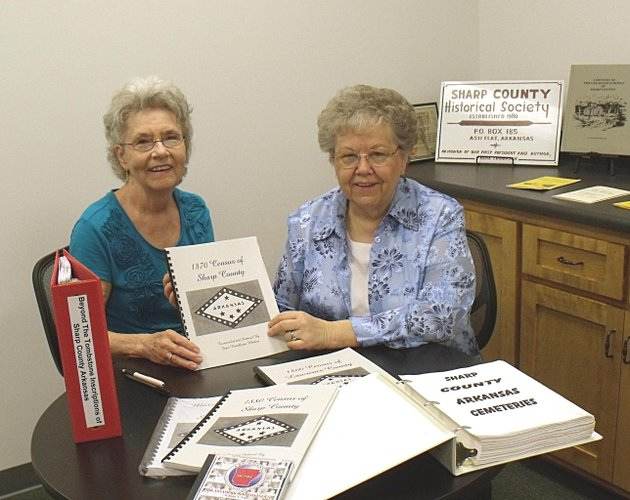 eva-royal-left-secretary-of-the-sharp-county-historical-society-accepts-a-book-with-sharp-county-genelogical-information-from-joayce-hambleton-whitten-for-the-society