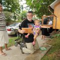 Laura JoAnn Grisham, 14 months, reaches for a book from the Little Free Library at the home of Aliso...