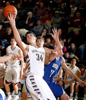 Arkansas Democrat-Gazette/JASON IVESTER --01/20/12 -- Siloam Springs junior Payton Henson stretches for a rebound against Harrison during the second half in Siloam Springs on Friday, Jan. 20, 2012.