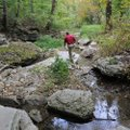 Chris Colclasure explores a stream on the property.