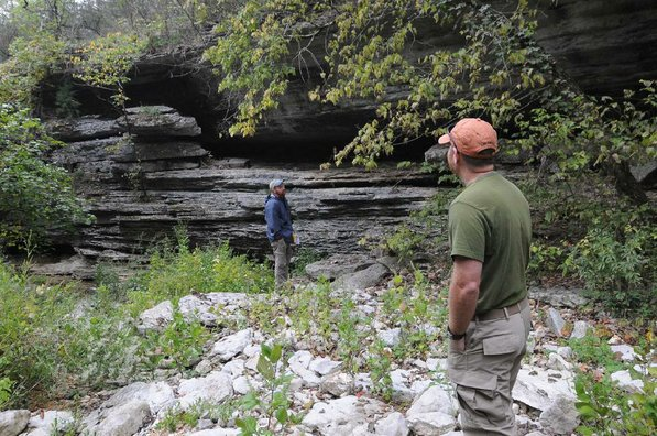 Theo Witsell, left, and Mike Slay explore a bluff area.