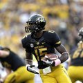 Missouri wide receiver Dorial Green-Beckham carries the ball during the first quarter of an NCAA col...