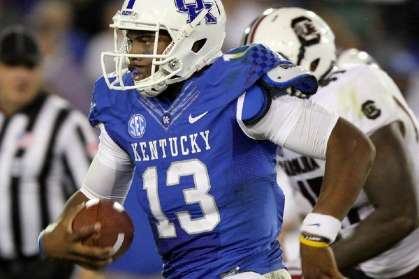Kentucky quarterback Jalen Whitlow (13), a true freshman who made his first start in a 27-14 loss to No. 20 Mississippi State, is expected to start against Arkansas on Saturday. Whitlow is one of three quarterbacks Kentucky has started this season.