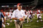 Arkansas Coach John L. Smith John L. Smith is 4-7 in first year at Arkansas and 136-93 in his 19th year overall.