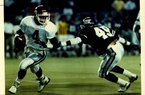 Former Arkansas quarterback Quinn Grovey (4) tries to avoide TCU's Edward Galariz during the Razorbacks' 41-19 victory in 1989, part of a 10-2 season for Arkansas in which it won the Southwest Conference championship. The following season, Grovey and Arkansas finished a disappointing 3-8.