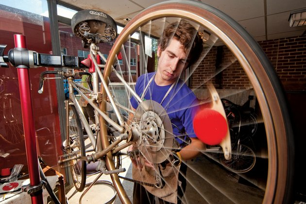 hendrix-senior-adam-grippo-works-on-a-bike-at-the-student-run-bike-shop-on-campus-grippo-began-repairing-his-own-bikes-in-high-school-to-save-money