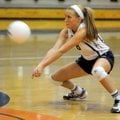 Maddie Elliott, a Shiloh Christian senior, digs the ball against Alma on Tuesday in Springdale.