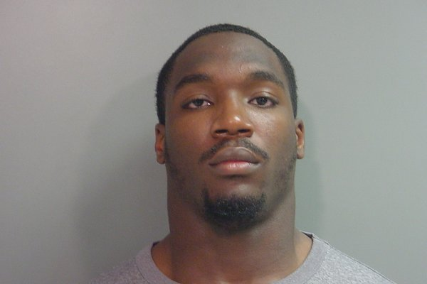Christopher Smith, an Arkansas defensive end, was arrested on Wednesday.