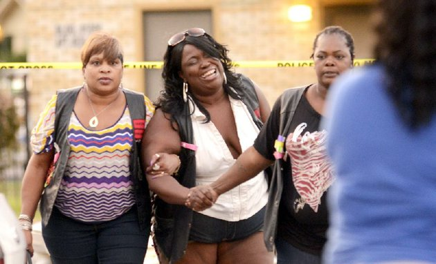 a-woman-reacts-to-the-news-of-a-relative-that-was-killed-at-the-silver-city-courts-housing-complex-in-north-little-rock-on-wednesday