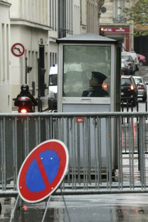 A French police officer keeps watch over a Paris synagogue Monday. A nation shamed by its collusion with the Nazis that sent thousands of Jews to their deaths during World War II is trying to crack down on anti-Semitism.