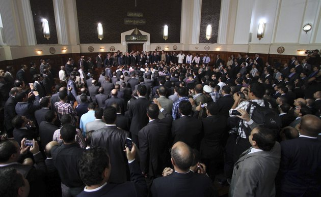 egyptian-prosecutor-general-abdel-meguid-mahmoud-speaks-to-hundreds-of-supporters-judges-lawyers-and-media-in-a-downtown-courthouse-defying-a-presidential-decision-to-remove-him-from-his-post-saying-this-infringes-on-the-judiciarys-independence-in-cairo-egypt-saturday-october-13-2012-president-mohammed-morsi-ordered-prosecutor-general-abdel-meguid-mahmoud-to-step-down-to-appease-public-anger-over-the-acquittals-of-ex-regime-officials-accused-of-orchestrating-violence-against-protesters-last-year