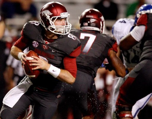 NWA Media/JASON IVESTER -- Arkansas quarterback Tyler Wilson rolls out of the pocket to pass against Kentucky during the second quarter on Saturday, Oct. 13, 2012, at Donald W. Reynolds Razorback Stadium in Fayetteville.